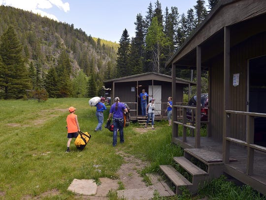 Campers check into their bunks at Camp Rotary in Monarch.