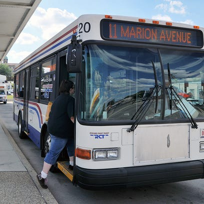 Buses pick up riders at the Richland County Transit
