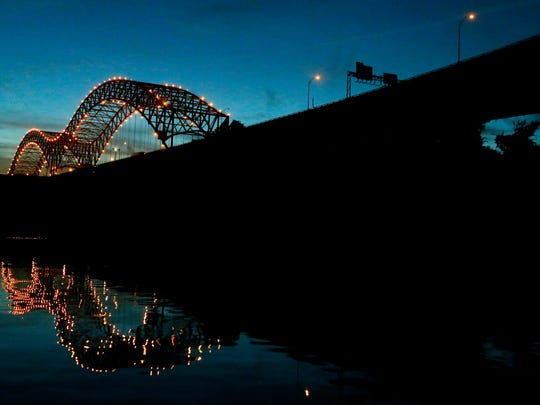 August 23, 2016 - The lights of the Hernando DeSoto Bridge reflect in the Memphis harbor at dusk. (Mike Brown/The Commercial Appeal)