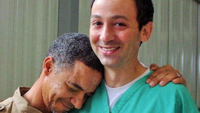 Louis Abrahams hugs Dr. Alex Cohen after his historic corneal transplant at the hands of the Iowa City ophthalmologist. It was the first corneal transplant on Swaziland soil and the only one to date.