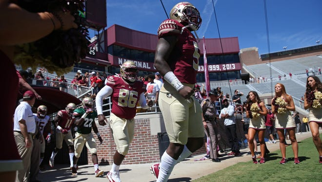 FSU's Dontavious Jackson charges out on to the field before their Garnet and Gold spring game at Doak Campbell Stadium on Saturday, April 8, 2017.