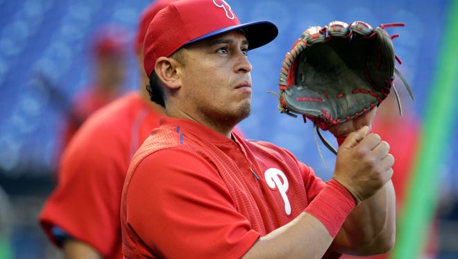 Philadelphia Phillies catcher Carlos Ruiz does drills before Friday's game against the Miami Marlins.