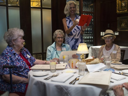 Suzi Wickman (group founder, standing) takes a photo of the over 90s lunch bunch during the monthly luncheon in June 2017. From left: Mary Lou Bennett, 91, Wilma Baker, 90, Helene Gay, 95, and Phyllis Cox, 93.