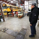 Jim White, Director of Transportation for HSE Schools out of Fishers, stands among just a few of the 283 buses that cover 82 square miles on a daily basis. White says the buses transport about 18,000 kids daily,  drive over two million miles a year and use around 7,000 gallons of diesel a week.