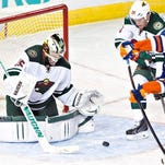 Minnesota Wild's goalie Darcy Kuemper (35) makes the save on Edmonton Oilers' Sam Gagner (89) as Ryan Suter (20) tries to defend during third period NHL hockey action in Edmonton, Alberta Thursday.
