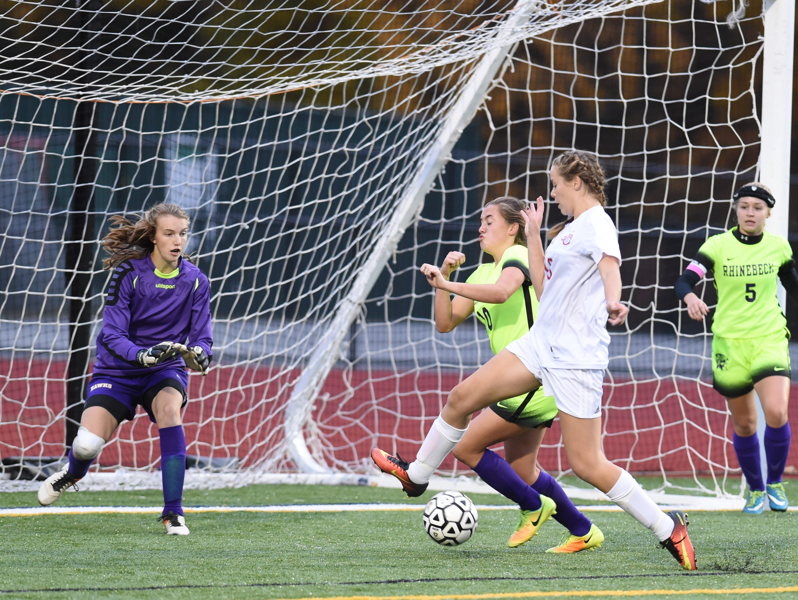 Red Hook's AJ Fuchs-White gets within striking distance of Rhinebeck's goal, as she's covered by, from left, Danielle Amidon, Sarah Tobias and Alex Dunn during Thursday's MHAL girls soccer championship at Franklin D. Roosevelt High School. Red Hook won 1-0.