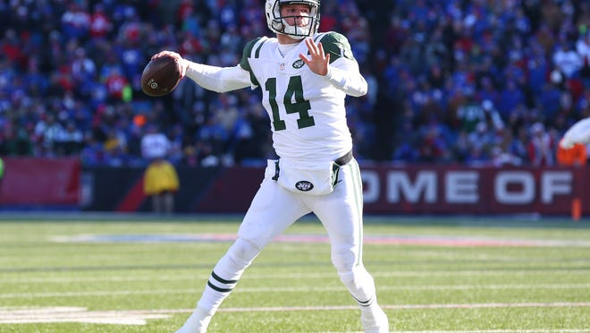 Dec 9, 2018; Orchard Park, NY, USA; New York Jets quarterback Sam Darnold (14) passes the ball against the Buffalo Bills during the second quarter at New Era Field. Mandatory Credit: Rich Barnes-USA TODAY Sports