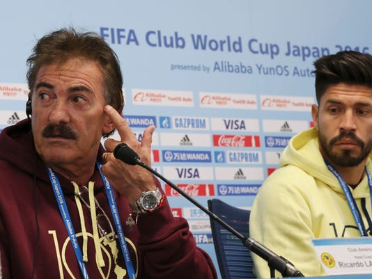Club America's Oribe Peralta, right, and team head coach Ricardo La Volpe, right, attend the official press conference at the FIFA Club World Cup soccer tournament at Suita City Football Stadium in Suita, western Japan, Saturday, Dec. 10, 2016. Club America will fight against Jeonbuk Hyundai Motors on Sunday. (AP Photo/Eugene Hoshiko)