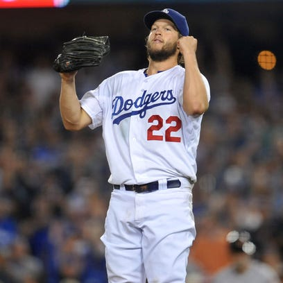 Dodgers starting pitcher Clayton Kershaw reacts following