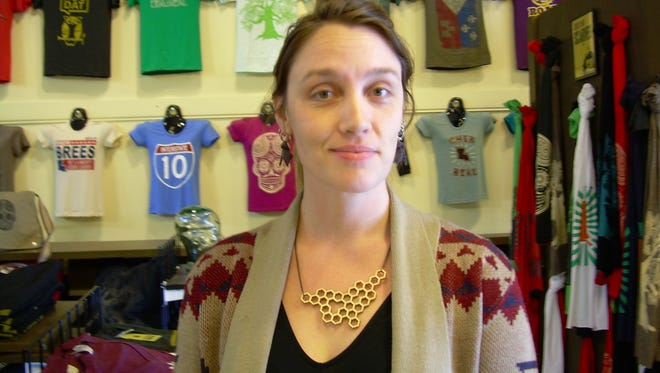 Jillian Johnson stands inside Parish Ink, the clothing store she co-owned. Johnson was killed in the Grand Theater shooting in July 2015.