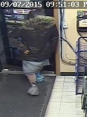 A male suspect is accused of robbing a Mishicot gas station at gunpoint.