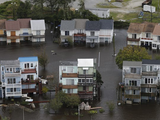 Homes along the New River are flooded as a result of high tides and rain from hurricane Florence which moved through the area in Jacksonville, N.C., Sunday, Sept. 16, 2018.