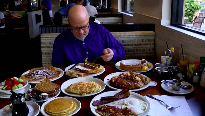 Dave Osborn, an editor at the Naples Daily News, samples breakfast dishes at the new Original Pancake House in Naples in December 2015.