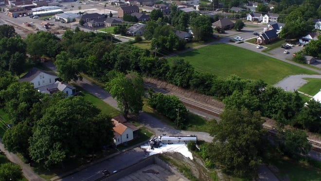 An aerial view of the overturned fuel tanker in Dickson. The tanker is in the bottom, middle of the photograph.