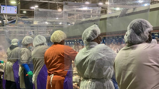 Tyson Foods has installed plastic barriers between worker stations at its meat and poultry plants to protect against transmission of the coronavirus.