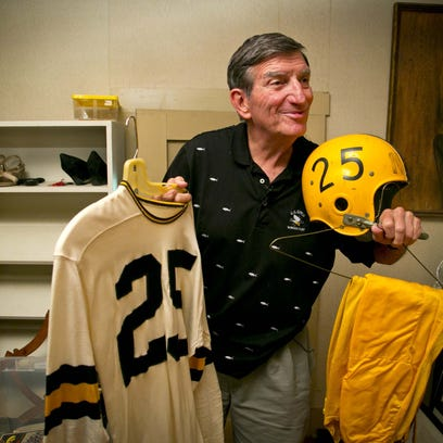 Randy Duncan displays his Iowa football uniform at