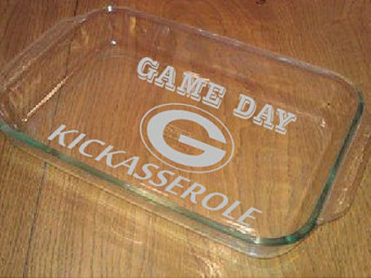 Game Day Kickasserole  We're betting you could show up with absolutely nothing in your casserole dish at the next game-day potluck and still be the hit of the party. We found this clever spin on glass bakeware etched with team pride from California-based Mile Stone Artworks on Etsy. Loan it out to fellow Packers fans at your own risk. $35 at etsy.com.