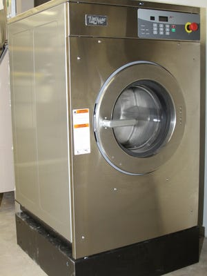 The new washer/extractor at the Malcom Volunteer Fire Department, which was acquired with funds from a grant donated by Mansanto.