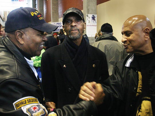 Hundreds marched in the Martin Luther King Jr. Day March in 2011. Homer Boyd, left, greets Nate Adams, right, before the march. Former city councilman Denny Whayne is pictured at center.