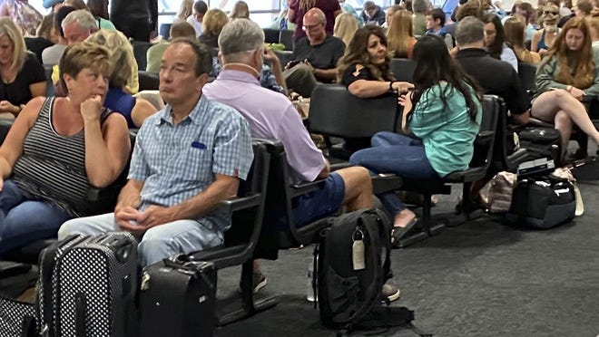 A photo provided by a passenger who did not want her name made public shows little attention being paid to social distancing or wearing face masks among passengers waiting at Rickenbacker International Airport on Sunday.