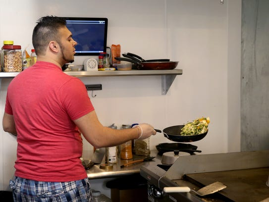 Owner and chef Nav Maju works in the kitchen at the