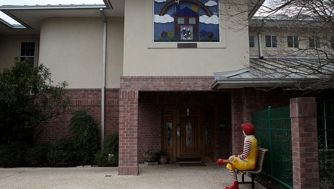 A Ronald McDonald statue sits at the entrance to the Ronald McDonald House in San Antonio's Medical Center.