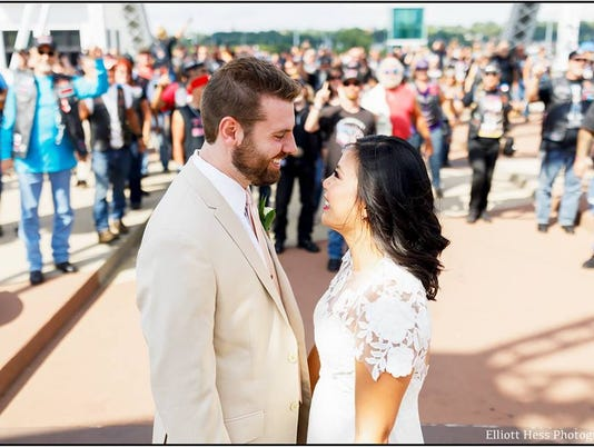 Nashville newlyweds receive biker gang blessing on pedestrian bridge