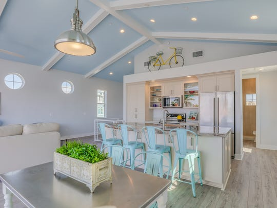 Pastel blue ceilings keep the Key West colorful look.