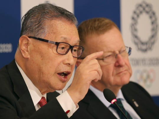President of the 2020 Tokyo Olympic and Paralympic Organizing Committee, Yoshiko Mori, speaks as IOC Vice President John Coates, right, listens during their joint press conference of the IOC coordination commission in Tokyo, Friday, Dec. 2, 2016. Further efforts to cut costs and the venues for five new sports were the focus of a coordination commission review of the Tokyo Olympics that wrapped up on Friday. Coates led a two-day meetings, held amid concerns about the budget for the 2020 Games. Construction costs have soared in part due to shortages in labor and materials as Japan also continues recovery from the 2011 earthquake and tsunami. (AP Photo/Koji Sasahara)