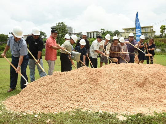 In this file photo from July 2018, Sinajana Mayor Robert Hofmann, third from left, is joined by former Gov. Eddie Calvo, seventh from right, and others at a groundbreaking ceremony for the Sinajana baseball field upgrade project.