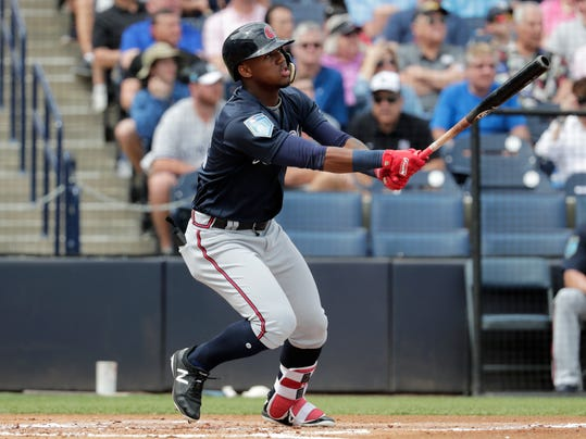 Atlanta Braves' Ronald Acuna watches after hitting a two run home run during the first inning of a baseball spring exhibition game against the New York Yankees, Friday, March 2, 2018, in Tampa, Fla. (AP Photo/Lynne Sladky)