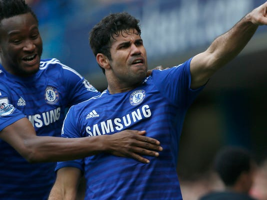 Chelsea's Diego Costa, right, celebrates after scoring his sides second goal of the game during their English Premier League soccer match between Chelsea and Arsenal at Stamford Bridge stadium in London Sunday, Oct. 5, 2014. (AP Photo/Alastair Grant)