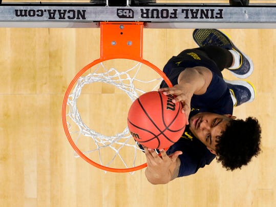 Michigan guard Ibi Watson dunks the ball during a practice session for the Final Four NCAA college basketball tournament, Friday, March 30, 2018, in San Antonio. (AP Photo/David J. Phillip)