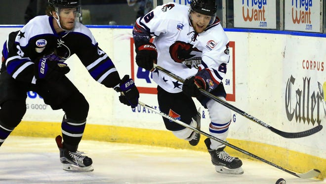 GABE HERNANDEZ/CALLER-TIMESIceRays' Brad Power skates to the puck against Lone Star Brahmas' Alex Stoley during the first period Saturday, Nov. 19, 2016, at the American Bank Center in Corpus Christi.