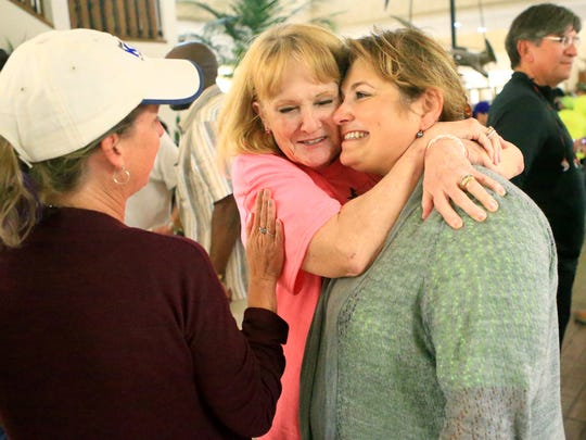 Rachel Wilken (center) hugs Inna Klein as they look at early voting numbers Tuesday, Nov. 8, 2016, at the Nueces County Courthouse in Corpus Christi.