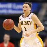 Minnesota Golden Gophers guard Rachel Banham, shown in this 2014 file photo, scored an NCAA-record 60 points Sunday.