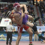 Norwich's Tristan Rifanburg, left, lifts Warsaw's Corey Farrell during Rifanburg's 6-1 victory in the quarterfinals of the Division II 145 bracket at the NYSPHSAA wrestling tournament Friday.