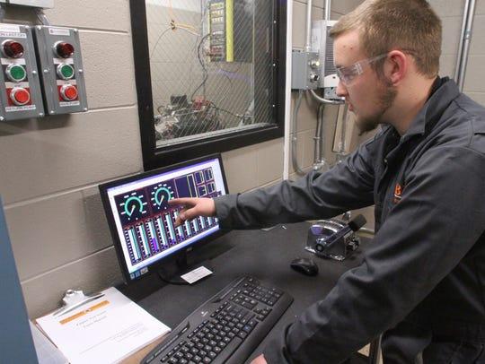 Student Brandon Bonin mans the controls for the engine