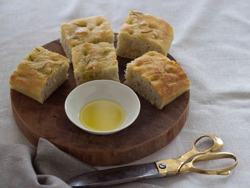 Focaccia, Italy: This thick and flat Italian bread is traditionally flavored with salt and olive oil, and topped with herbs or other ingredients such as olives or onions.