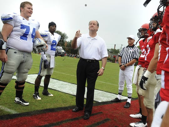 Then-U.S. Rep. Bobby Bright, D-Montgomery, tosses the coin at midfield before the Faulkner  Huntingdon game in Montgomery, Ala. on Saturday September 12, 2009.(Montgomery Advertiser, Mickey Welsh)