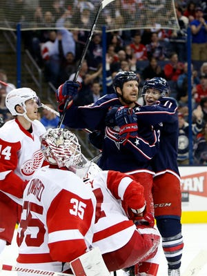 Columbus Blue Jackets' Matt Calvert, right, and David Clarkson celebrate their goal against the Detroit Red Wings during the second period of an NHL hockey game, Tuesday, March 8, 2016, in Columbus, Ohio.
