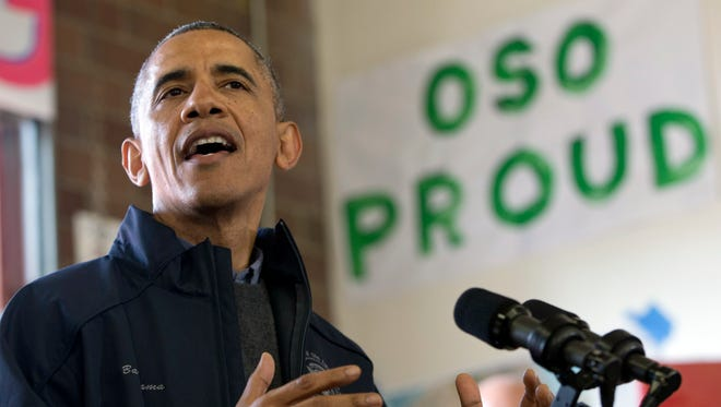 President Obama speaks to first responders, recovery workers and community members at the Oso Fire Department in Oso, Wash., Tuesday, April 22, 2014, the site of the deadly mudslide that struck the community in March.