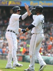 Tigers DH Victor Martinez and rightfielder J.D. Martinez