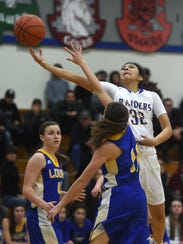 Reed's Larsa Guzman (32) drives while taking on Lowry