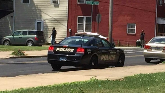 York City Police stop briefly Sunday near the area where a boy, 12, was shot the previous day during a gun battle between people in two vehicles, police say.