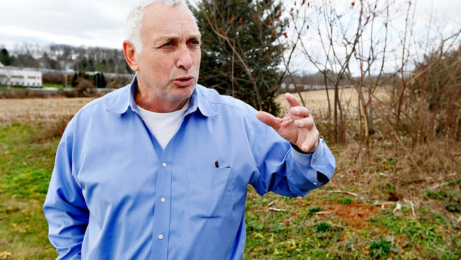 Southern York County developer Phil Robinson, of Southern Chestnut Commerce Center, is shown on land that he has owned, since 1992, in Shrewsbury, Pa. on Tuesday, Dec. 15, 2015. Robinson has been unable to develop the property, despite the 600-800 jobs it could provide, due to a lack in sewer credits.