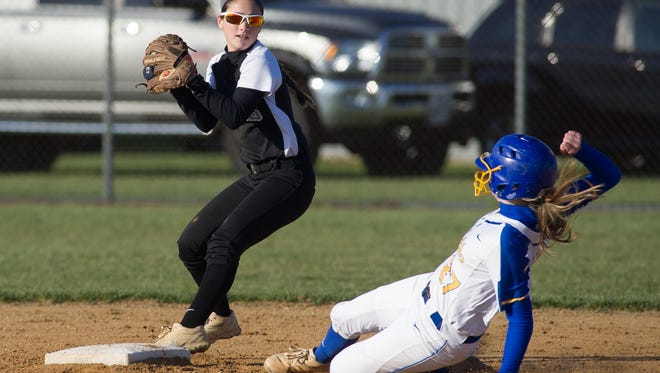 Sussex Tech's Jenna Calloway (left) forces out a Sussex Central runner on March 22. The Ravens are 10-1 and ranked No. 2 in the state.
