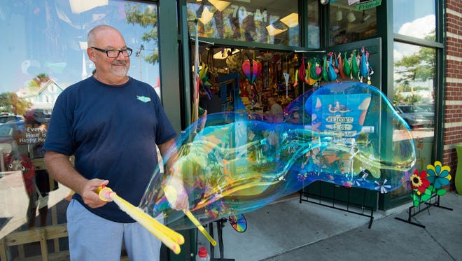 Steve Bunte, demonstrates one of their bubble making products at Rehoboth Toy & Kite Company store on Rehoboth Avenue.