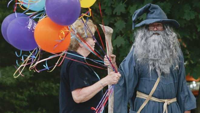 Balloon seller Andrea Pustell walks past Gandalf (Clay Ridings) during the Arden Fair last year.