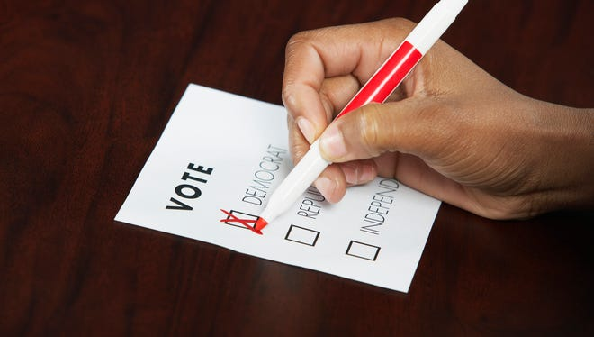 Woman marking voting form.